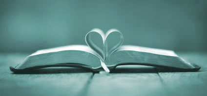 open Bible with pages open in heart shape