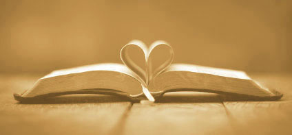 Bible with pages open in heart shape