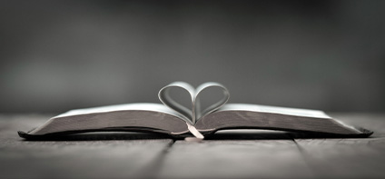 Bible open in heart shape