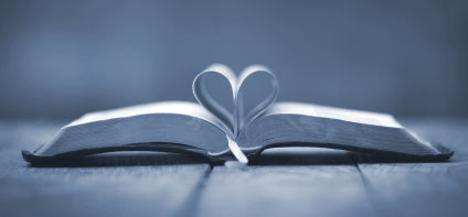 Open Bible with pages in heart shape