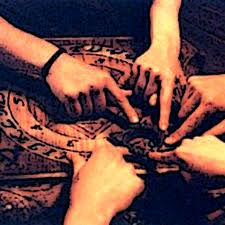 Hands on the Ouija Board