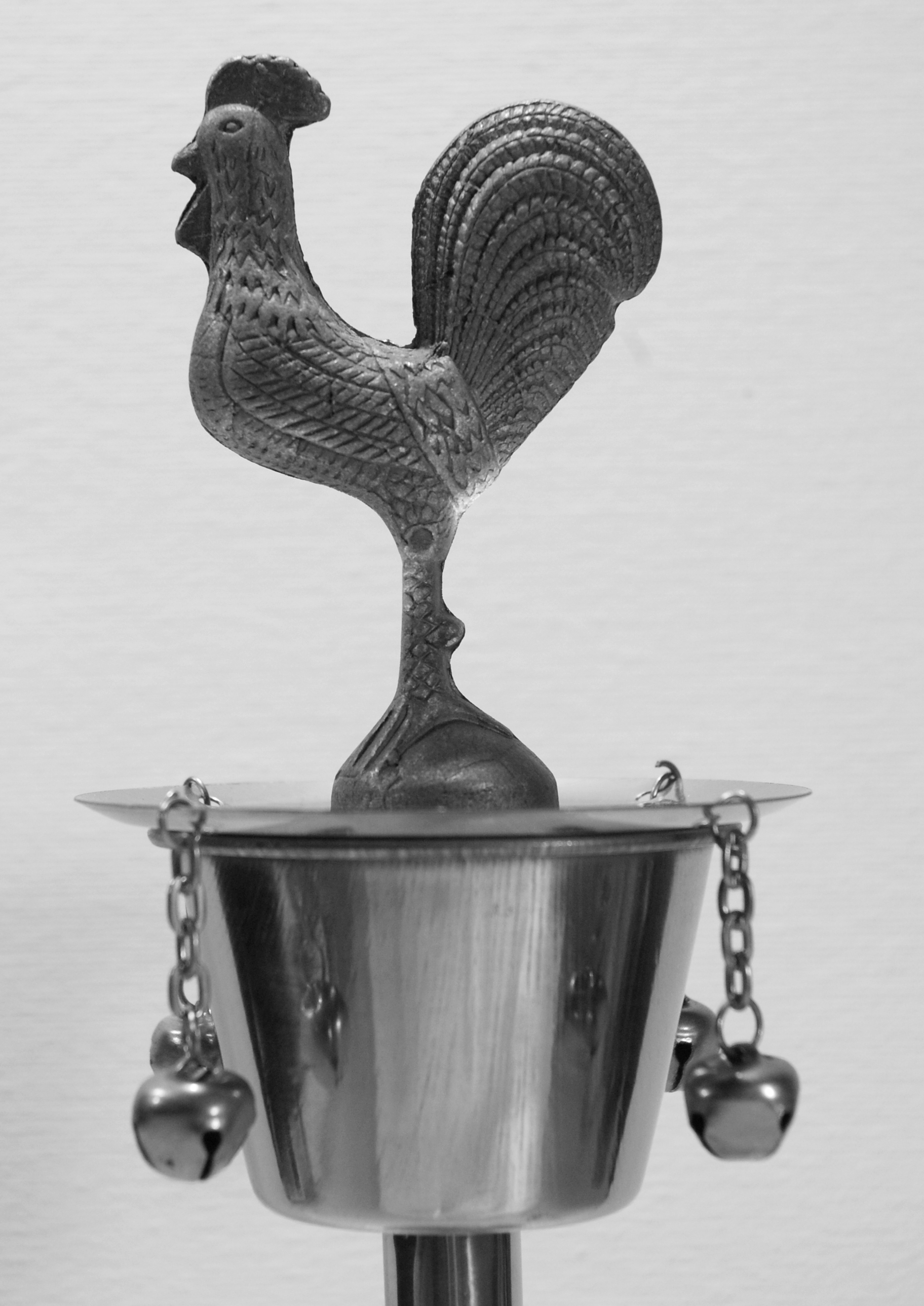 Rooster atop the iron chalice of Osun