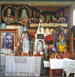 Santeria altar with many objects and Catholic related saint figurines