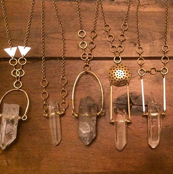 row of necklaces made with quartz crystals