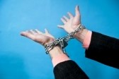 Hands outstretched in chains