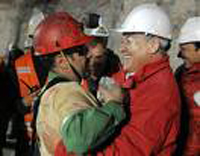 chile mine rescue hug