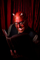 devil with book